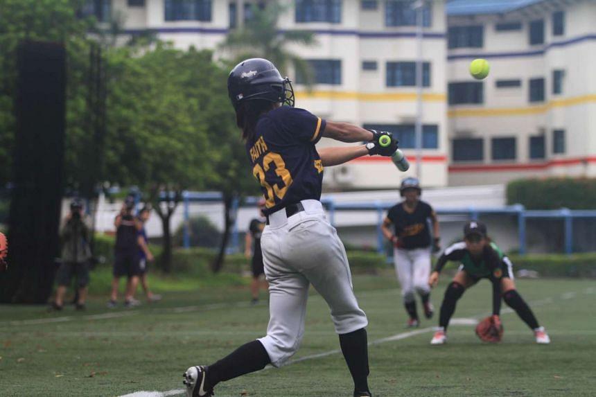ACJC's shortstop Faith Gan hitting a home run in the National Schools A Division softball girls final against RI.