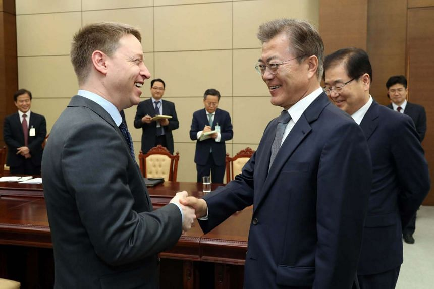 South Korean President Moon Jae In (right) meets with Matt Pottinger (left), US National Security Council (NSC) director for East Asia, at Cheong Wa Dae in Seoul, South Korea, on May 16, 2017.