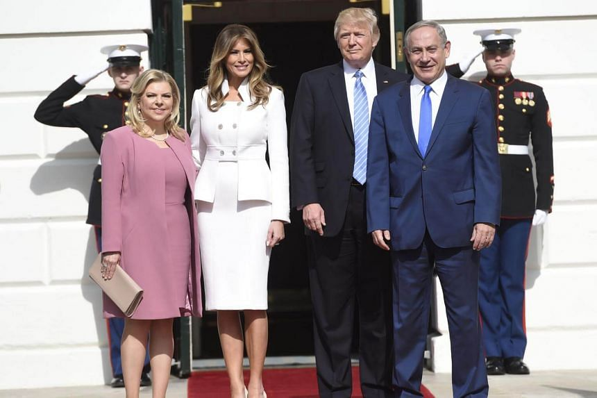US President Donald Trump and First Lady Melania Trump welcome Israeli Prime Minister Benjamin Netanyahu and his wife, Sara, as they arrive at the White House in Washington, DC, on Feb 15, 2017.