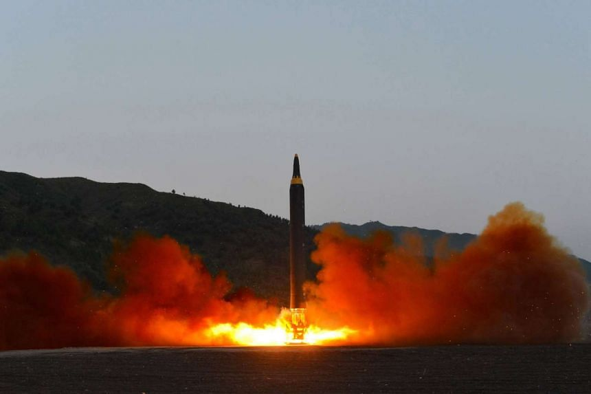An undated photo released on May 15, 2017 by North Korean Central News Agency (KCNA) showing the test-firing of a new ground-to-ground medium long-range strategic ballistic rocket Hwasong-12 on May 14, 2017.