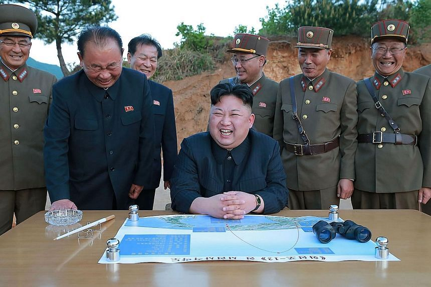 North Korean leader Kim Jong Un attending the test launch of a Hwasong-12 missile at an undisclosed location on Sunday.