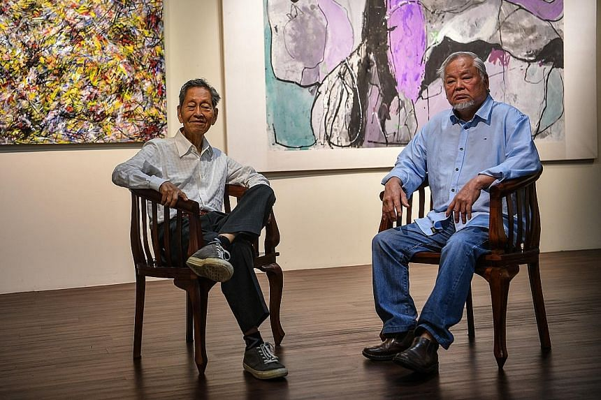Choy Weng Yang (left) and Wong Keen in front of their pieces Radiant Lotuses and Lotus XX.