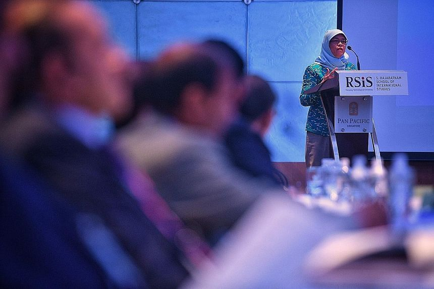 """Madam Halimah Yacob said trade enables Singapore to """"further capitalise on its comparative advantage and deepen economic linkages with (its) partners""""."""