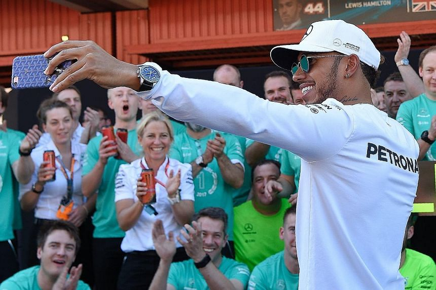 Lewis Hamilton taking a wefie with the Mercedes crew after beating Sebastian Vettel to win the Spanish Grand Prix on Sunday.