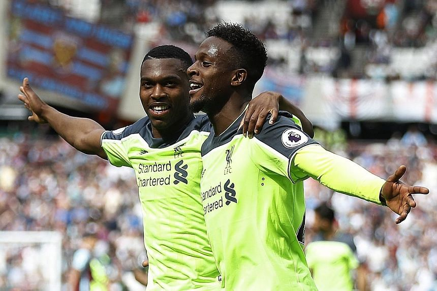 Liverpool's Divock Origi celebrates scoring their fourth goal against West Ham with Daniel Sturridge (far left), who himself netted the opener in a 4-0 win. The victory left Liverpool needing three more points to seal a top-four finish and qualificat
