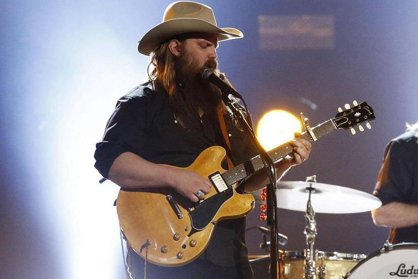 Chris Stapleton performing at the 52nd Academy of Country Music Awards.