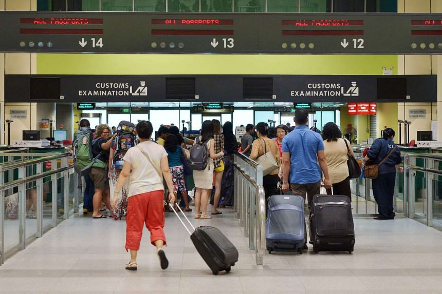 """ICA said the immigration clearance system at both the Woodlands and Tuas checkpoints is experiencing """"intermittent slowness""""."""