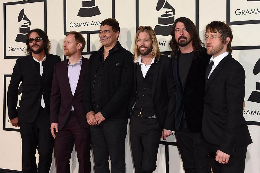 From left: Franz Stahl, Nate Mendel, Pat Smear, Taylor Hawkins, Dave Grohl and Chris Shiflett of the  Foo fighters arriving  at  the 58th Annual Grammy Music Awards in Los Angeles in February.