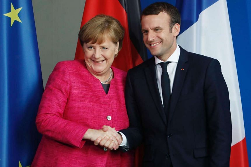 German Chancellor Angela Merkel and French President Emmanuel Macron   after addressing a press conference at the chancellery in Berlin on May 15.