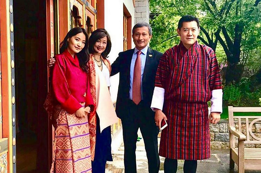 Dr Balakrishnan (second from right) and his wife (second from left)  with Bhutan's royal couple.