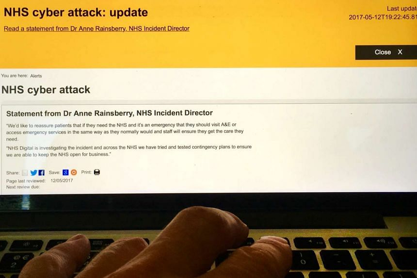 A close-up view of Britain's National Health Service (NHS) website with a cyber attack warning, as seen on a laptop in London on May 13, 2017.