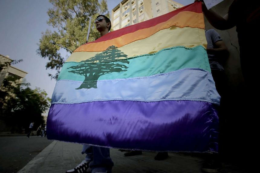 A gay pride flag flies at an anti-homophobia rally in Beirut in a 2013 file photo.
