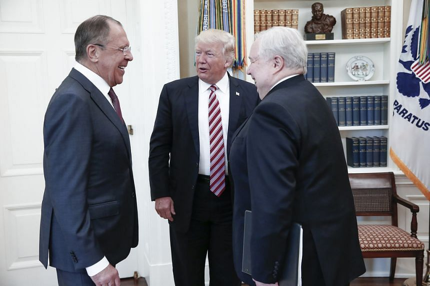 A handout photo made available by the Russian Foreign Ministry on May 10, 2017 shows US President Donald Trump speaking with Russian Foreign Minister Sergei Lavrov (L) and Russian Ambassador to the US Sergei Kislyak during a meeting at the White Hous