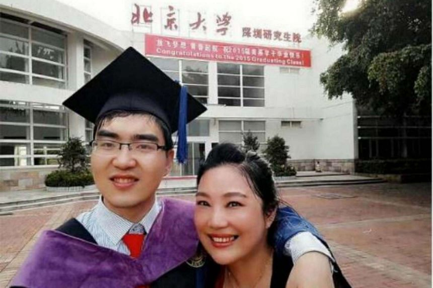 Mr Ding Ding posing with his mother Zou Hongyan outside Peking University.