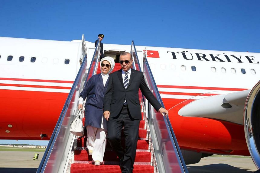 Turkish President Tayyip Erdogan, accompanied by his wife Emine Erdogan, disembarks from a plane upon his arrival in Washington, US on May 15, 2017.