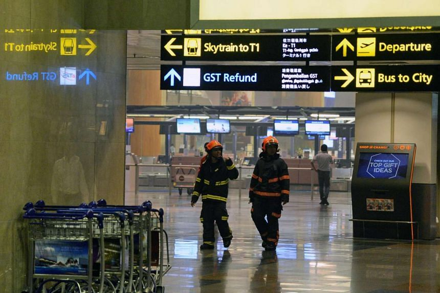 Firemen inspect Changi International Airport terminal 2 in Singapore on May 16, 2017.