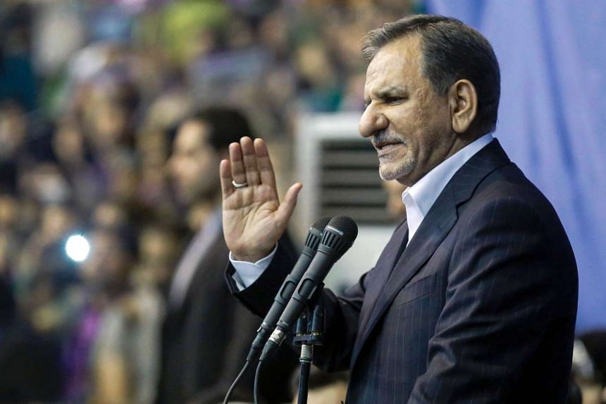 Iranian vice-president Eshaq Jahangiri waving to the crowd as he attends a campaign rally for the upcoming presidential elections in the capital Tehran on May 13, 2017.