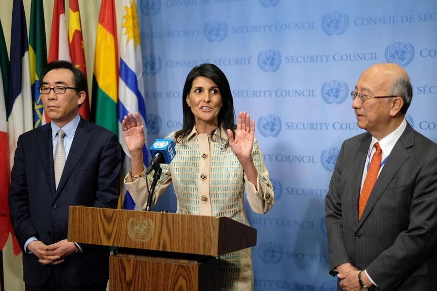 US Ambassador to the United Nations Nikki Haley (centre) at a press briefing as Japanese Ambassador Koro Bessho (left) and South Korean Ambassador Tae-yul Cho listen before a Security Council meeting on the situation in North Korea.