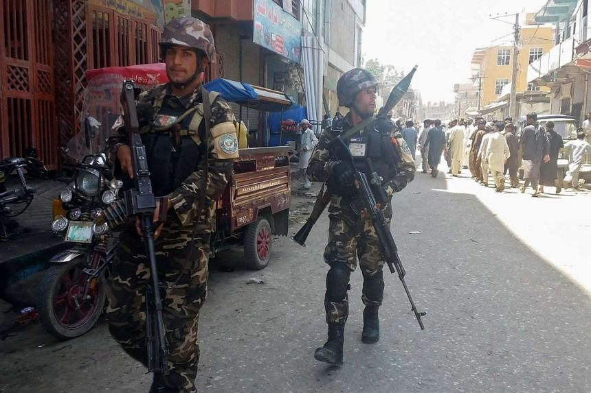 Afghan security forces arrive at the site of an attack in Jalalabad city, eastern Afghanistan on May 17, 2017.