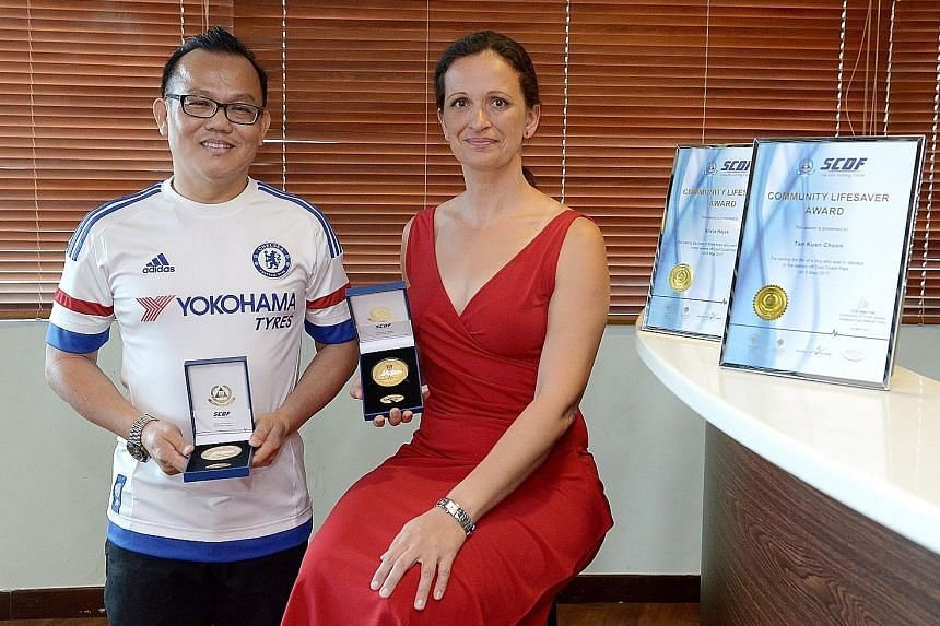 Mr Tan Kian Choon and Ms Silvia Hajas received the Community Lifesaver Award yesterday. Earlier this month at East Coast Park, Ms Hajas rescued two boys at sea while Mr Tan helped her save a third.
