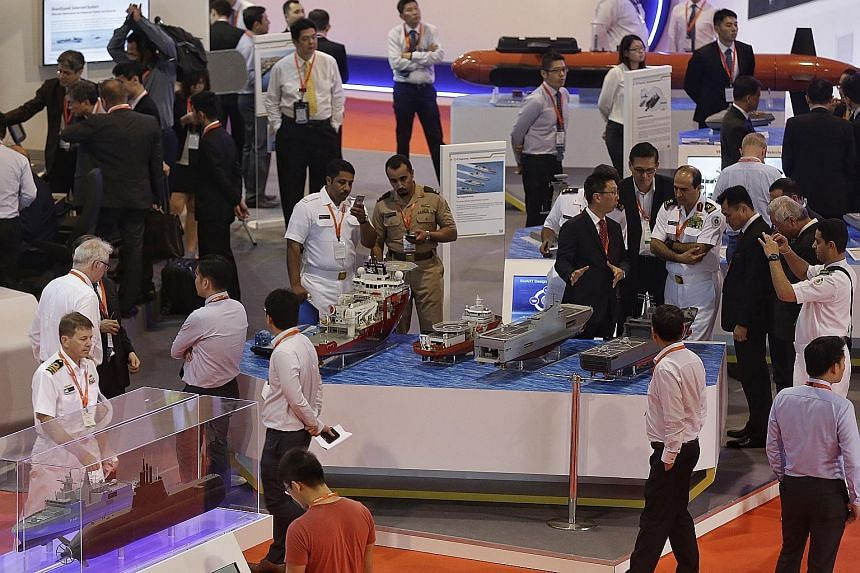 Visitors browsing the booths at the Imdex Asia defence trade fair at Changi Exhibition Centre yesterday.