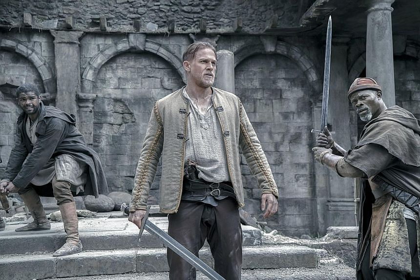 Charlie Hunnam (centre) and Djimon Hounsou (right) in King Arthur: Legend Of The Sword.