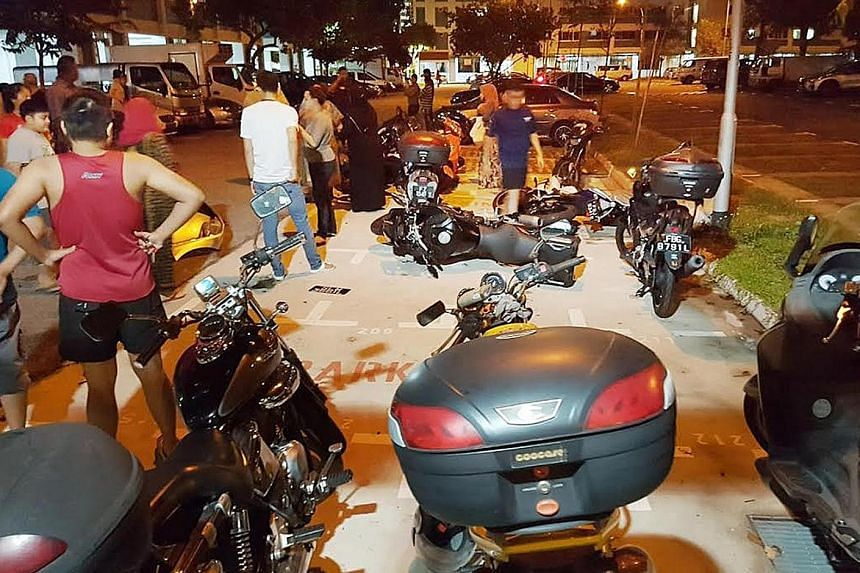 An eyewitness told Shin Min Daily News that even after he hit the motorcycles, the driver continued driving. He got out of his car only when he was about 100m away, but drove away again, leaving behind broken motorcycle parts, as well as the car's bu