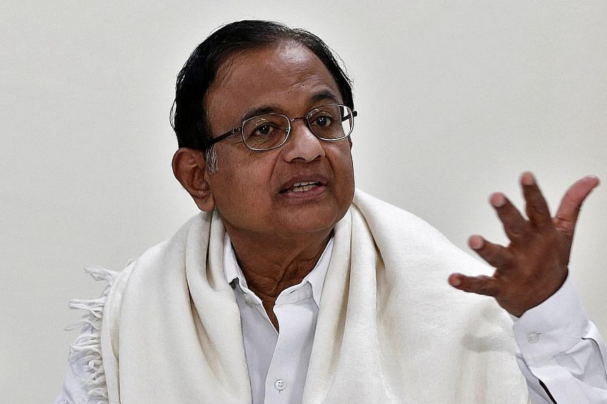 Mr Karti Chidambaram talking to the media after the Central Bureau of Investigation raided his house in Chennai yesterday. He and his father P. Chidambaram (below) are accused of criminal misconduct in granting approval for foreign investment deals,