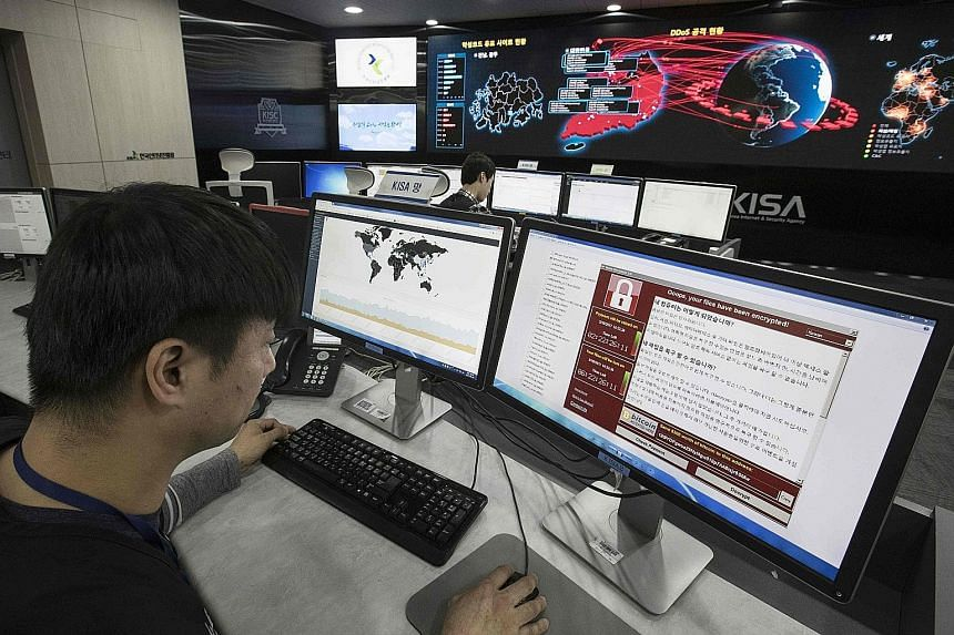 Staff at the Korea Internet and Security Agency in Seoul monitoring the spread of ransomware attacks on Monday. WannaCry has hit more than 300,000 computers worldwide.