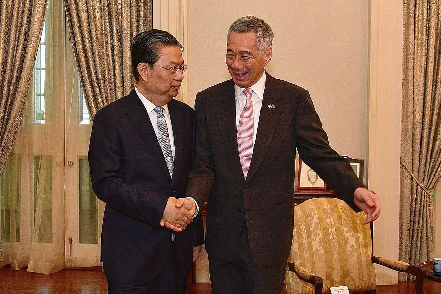 China's Central Organisation Department Minister Zhao Leji calling on Prime Minister Lee Hsien Loong at the Istana yesterday. They spoke about regional issues and affirmed close ties between China and Singapore.