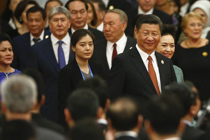 President Xi Jinping and his wife Peng Liyuan (on his left) arriving for the welcoming banquet for the Belt and Road Forum at the Great Hall of the People in Beijing on Sunday.