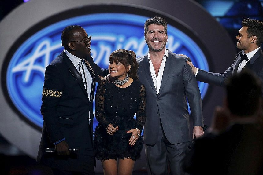 From left: Former judges of American Idol Randy Jackson, Paula Abdul, Simon Cowell and host Ryan Seacrest at the American Idol Grand Finale in Hollywood, California, last year.