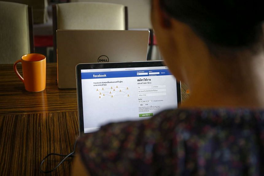 A person using a computer displaying the Thai Facebook login page in Bangkok on May 9.
