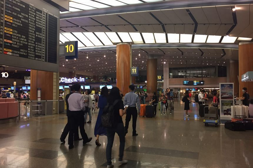 People streaming into the departure hall at Changi Airport Terminal 2 in the wee hours of Wednesday (May 17).