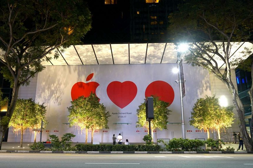Close to midnight of May 16, 2017, workers added the opening date to the front facade of the Apple store at Knightsbridge mall.