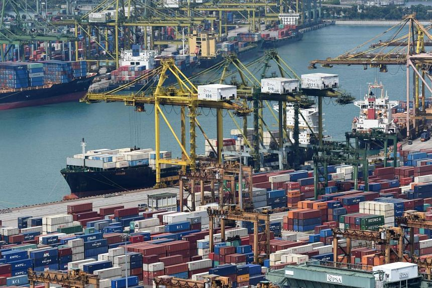 Vessels are docked along the container port in Singapore.