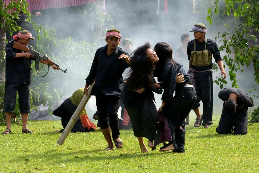 Cambodian fine arts school students take part in a performance to mark the annual 'Day of Anger' at the Choeung Ek killing fields memorial in Phnom Penh on May 18, 2017.