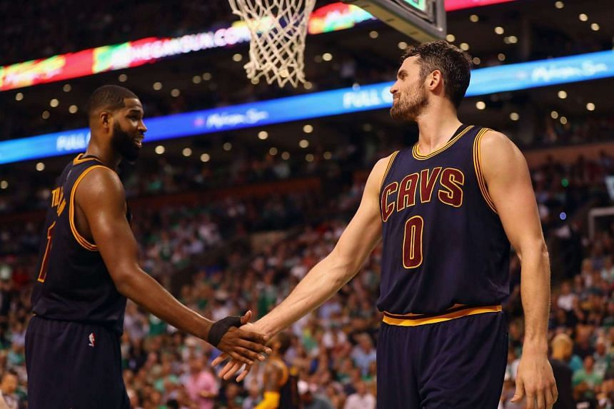 LeBron James poured in 38 points, while Kevin Love (right) and Tristan Thompson (left) put up 32 and 20 respectively as the Cleveland Cavaliers romped to a 117-104 win over the Boston Celtics in Game One of the Eastern Conference finals.