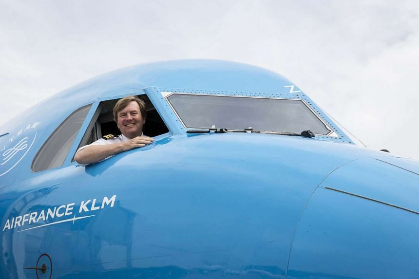 Dutch King Willem-Alexander looking out from the window of a KLM Cityhopper aircraft at Schiphol Airport, near Amsterdam, on May 16, 2017.
