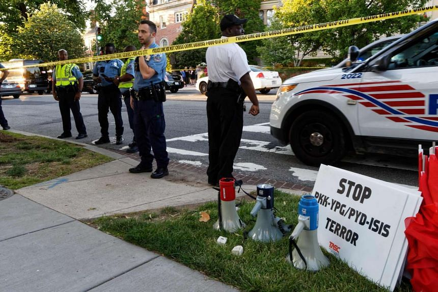 Police secure the street outside the Turkish embassy during a visit by Turkish President Recep Tayyip Erdogan on May 16, 2017, in Washington, DC.