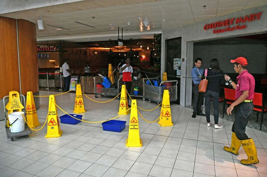 Cleanup operations around Chutney Mary and Nando's, which were among the areas damaged as a result of the fire on Tuesday (May 16).