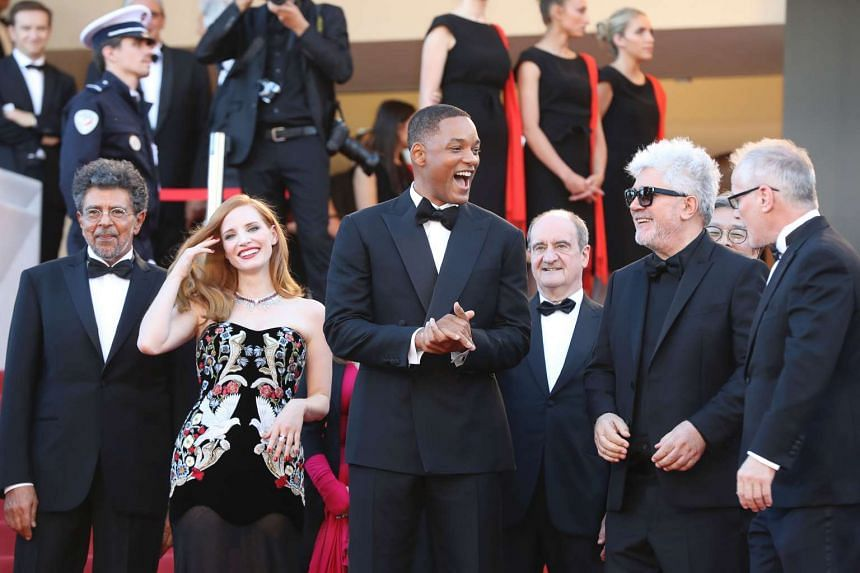 (From left) Gabriel Yared, Jessica Chastain, Will Smith and Pedro Almodovar are greeted by General Delegate of the Cannes Film Festival Thierry Fremaux (right) on May 17, 2017.