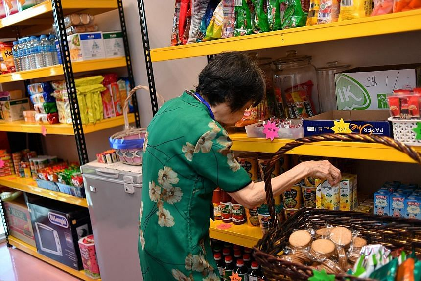"""Above: Hairstylist Jacqueline Lee giving Madam Ng a haircut in a salon with pictures of icons from the 1980s. Left: Massage therapist Quek Chin Poh giving Madam Ng a massage, which cost her """"20 cents"""". Madam Jennifer Ng choosing snacks at the minimar"""