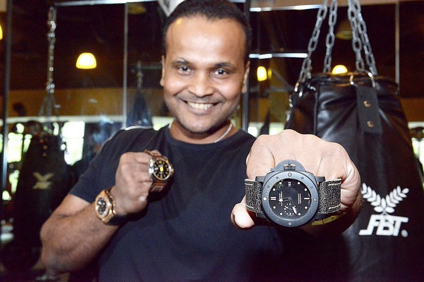 Gym owner Mohamed Fazlon with three pieces he bought from pre-owned luxury watch dealers: (from left) Hublot Big Bang, Panerai PAM 1BT and Panerai PAM508. Mr Nick Lim, director of Chuan Watch at Golden Landmark, says his shop offers buy-back guarante
