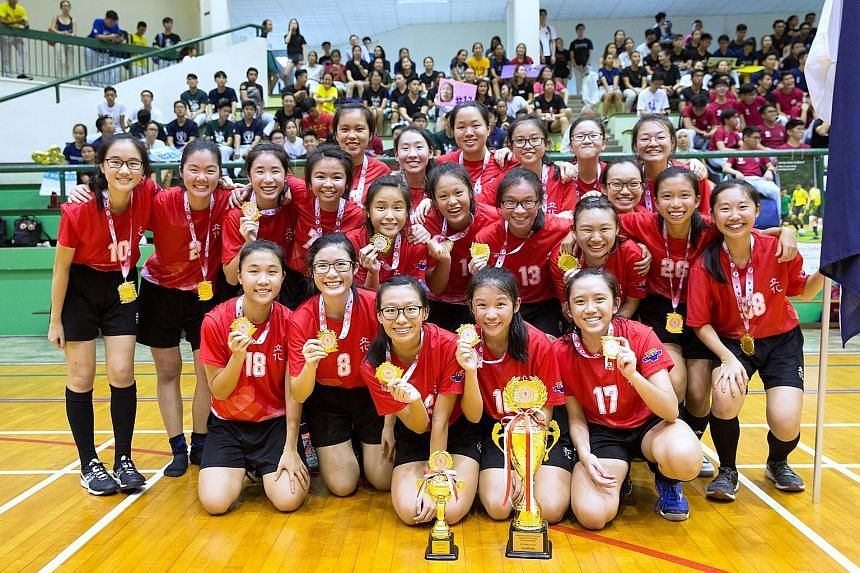 River Valley High celebrated their first A Division girls' floorball title after See Yuanru (No. 17) scored the winning goal in a penalty shoot-out win over MJC, who were also losing finalists last year. Ng Jun Wei high-fives captain Koh Dun Xian sho