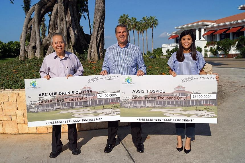 Arc Children's Centre board director Yeo Lee Hock (left) and Assisi Hospice's head of communications & community engagement Juliet Ng (right), with Sentosa Golf Club's (SGC) general manager Andrew Johnston at a cheque presentation ceremony yesterday.
