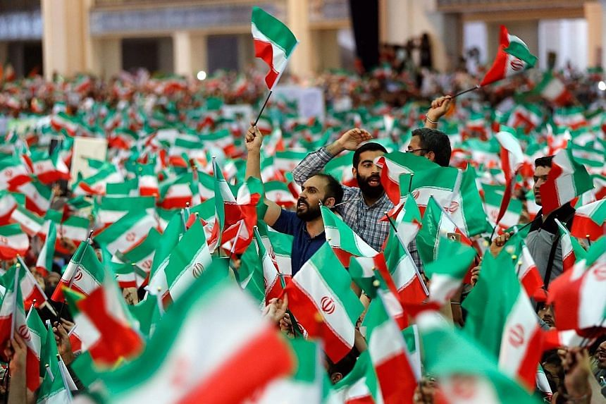Supporters of Mr Ebrahim Raisi at a presidential election campaign rally in Teheran on Tuesday.