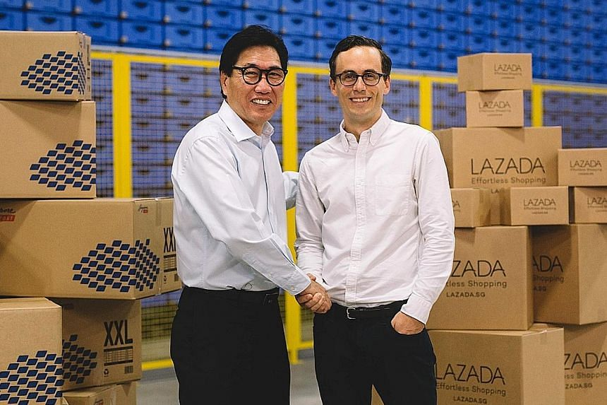 Mr Sam Ang, executive vice- president at SingPost, with Mr Alexis Lanternier, CEO of Lazada Singapore, in Lazada's new warehouse at the SingPost Regional eCommerce Logistics Hub in Tampines.