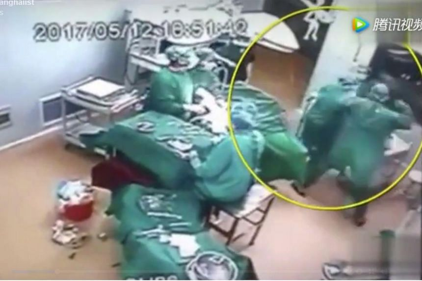 Medical workers caught on CCTV fighting in the operating theatre at a hospital in Henan.