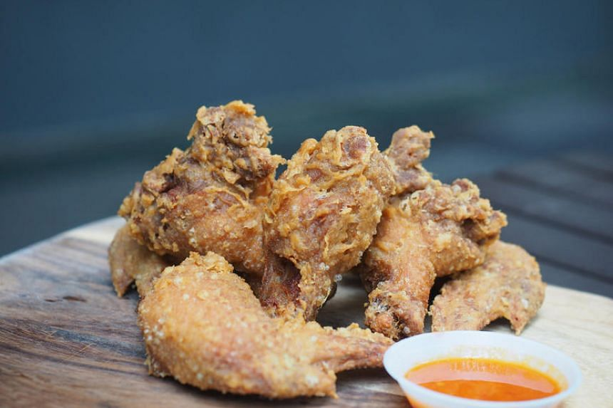 Chicken wings from Two Wings come in various guises, including one slathered generously with salted-egg yolk sauce. PHOTO: IRENE SOH